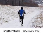 the guy is engaged in jogging...   Shutterstock . vector #1273629442