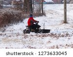 the guy snowing the road with a ...   Shutterstock . vector #1273633045