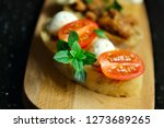 bruschetta with mozzarella... | Shutterstock . vector #1273689265