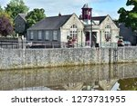 Kilkenny City Branch Library stone building with purple tower on bank of river Nore.