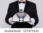 waiter serving a meal under a...   Shutterstock . vector #127375142