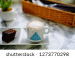 macchiato with chocolate cake   Shutterstock . vector #1273770298