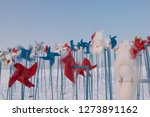 pinwheels on the snow field | Shutterstock . vector #1273891162