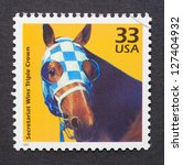 Small photo of UNITED STATES - CIRCA 1999: a postage stamp printed in USA showing an image of Secretariat the first racehorse to win the US Triple Crown, circa 1999.