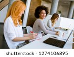 businesswomen working in the... | Shutterstock . vector #1274106895