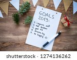 top view of notepad with goals... | Shutterstock . vector #1274136262