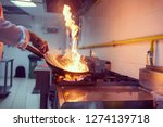 chef cooking and doing flambe... | Shutterstock . vector #1274139718