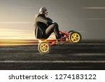 businessman doing a wheelie on...   Shutterstock . vector #1274183122