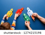 father and little son are... | Shutterstock . vector #1274215198