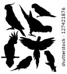 silhouettes of parrots | Shutterstock .eps vector #127421876