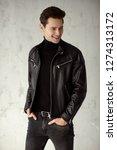 young handsome man wear black...   Shutterstock . vector #1274313172