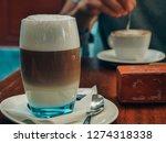 delicious latte macchiato    Shutterstock . vector #1274318338