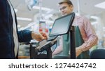 at the supermarket  checkout...   Shutterstock . vector #1274424742