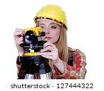 Land Surveyor Working With...