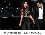 sexy couple near the car.... | Shutterstock . vector #1274509162
