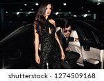 sexy couple in the car.... | Shutterstock . vector #1274509168