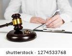 judge gavel deciding on...   Shutterstock . vector #1274533768