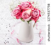 pink roses in a white pitcher.... | Shutterstock . vector #1274537758