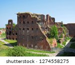 ruins of buildings affected in... | Shutterstock . vector #1274558275