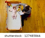 mother soothing her baby with... | Shutterstock . vector #127485866