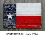 Texas flag made from painted wood slats on a wood fence - stock photo
