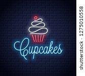 cupcake neon logo on wall... | Shutterstock .eps vector #1275010558