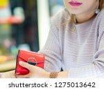 selective focus red bag in hand ... | Shutterstock . vector #1275013642