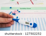 woman hand holding thermometer... | Shutterstock . vector #127502252