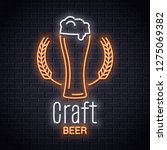 beer glass with wheat neon logo.... | Shutterstock .eps vector #1275069382