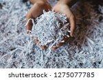 hand showing heap of shredded... | Shutterstock . vector #1275077785