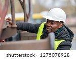african american mechanic... | Shutterstock . vector #1275078928