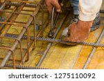 bricklayer at work in a... | Shutterstock . vector #1275110092