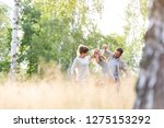 happy parents playing with...   Shutterstock . vector #1275153292