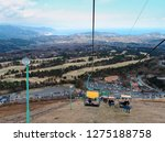 tourists taking the chairlift... | Shutterstock . vector #1275188758