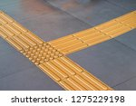 bright yellow tactile paving... | Shutterstock . vector #1275229198
