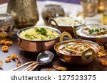indian food in brass bowl | Shutterstock . vector #127523375