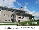 Church at Laurentians Mountains in Quebec, Canada - stock photo