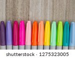 colorful markers on a weathered ...   Shutterstock . vector #1275323005
