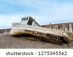 A Wrecked Boat On The Shore...