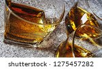 whiskey in glasses on a bright... | Shutterstock . vector #1275457282