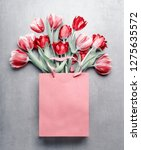 red tulips in paper shopping... | Shutterstock . vector #1275635572