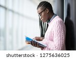 young afro american girl...   Shutterstock . vector #1275636025