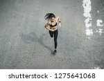 fitness woman she is running... | Shutterstock . vector #1275641068