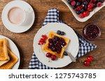 breakfast. toasts with cherry...   Shutterstock . vector #1275743785