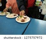 people picking hainanese... | Shutterstock . vector #1275757972