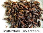 insect pile fried crickets on... | Shutterstock . vector #1275794278