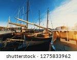 boats in la maddalena harbor at ... | Shutterstock . vector #1275833962
