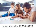 a family draws on paper lying... | Shutterstock . vector #1275863992