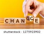 woman hand flip wooden cube... | Shutterstock . vector #1275923902