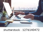 young businessman working on... | Shutterstock . vector #1276140472